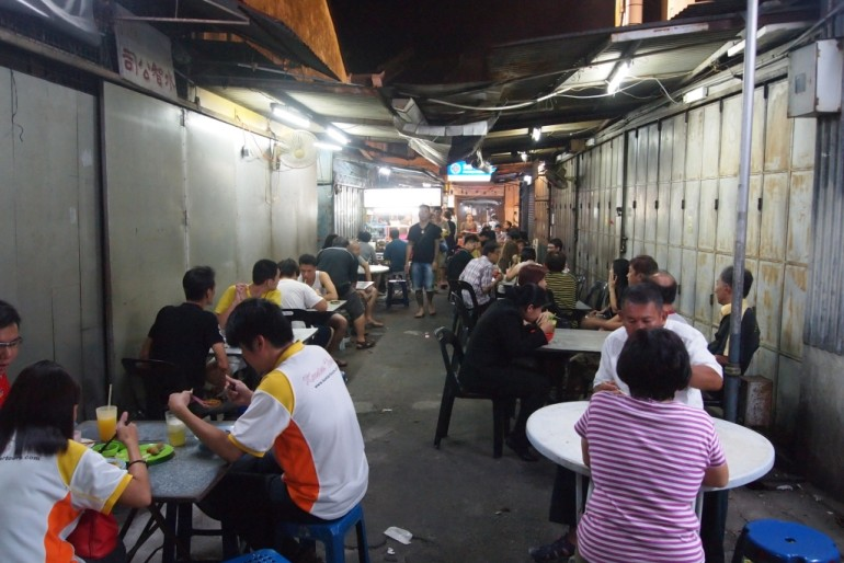 An alley full of eating patrons
