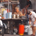 Old Chinese vendors cooking traditional street food - Penang