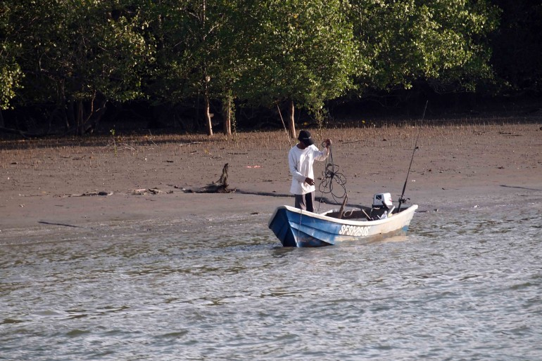 A local fisherman at the river mouth