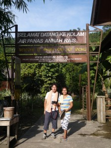 At the hot springs entrance with Miss Karum my host