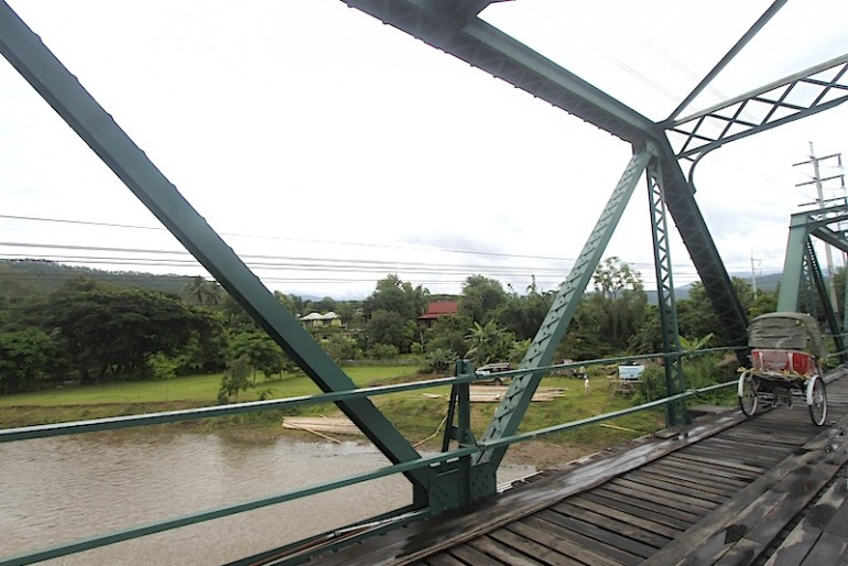 Tourists crossing Pai memorial bridge