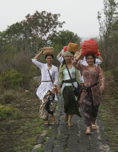 Ceremony women walking around the island paths