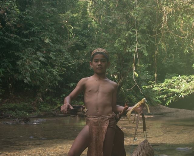 Dayak boy by the river