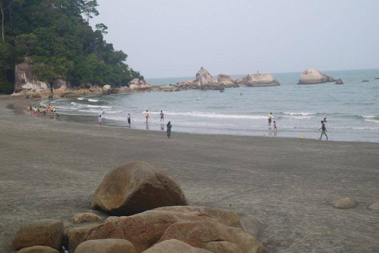 Teluk Cempedak beach rocks and sand