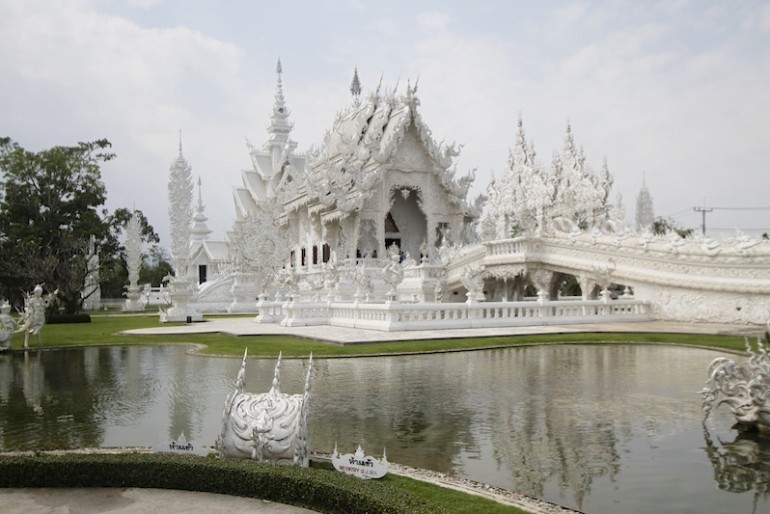 Wat Rong Khun main temple and the carps lake