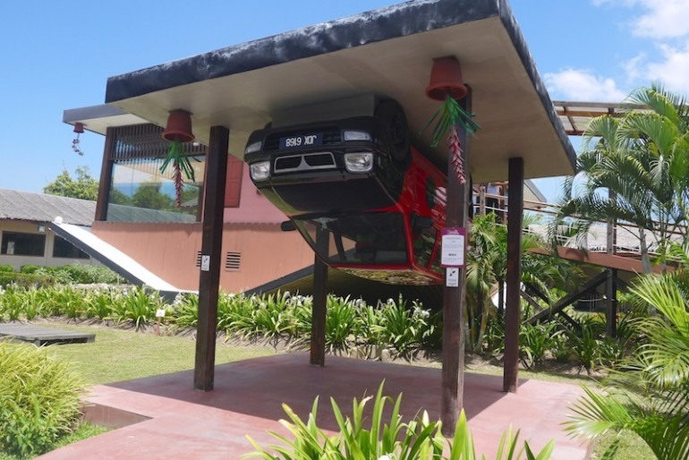 Rumah Terbalik porch with car
