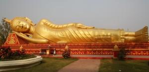 Impressive reclining Buddha at Pha That Luang