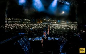DJ cheering the crowd at Sunburn Festival