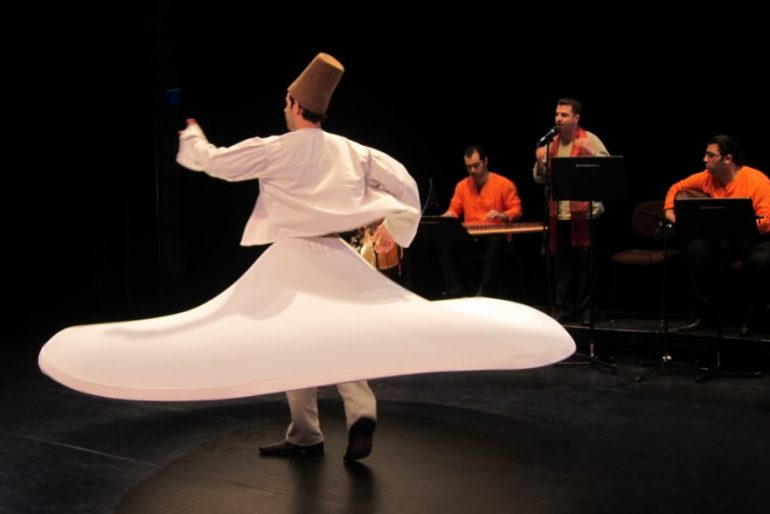 Dervish dance in a traditional white Sufi costume