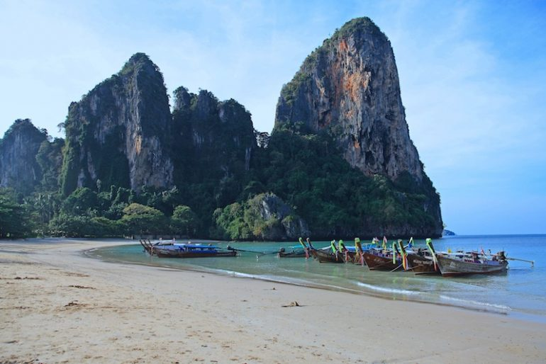 The amazing Railay West bay, with longtail boats docked