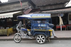 A Luang Prabang version of tuk tuk waiting for next ride