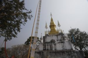 Golden stupa at top of Phra That Phu Si