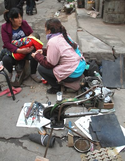 Street shoe repair and tailors
