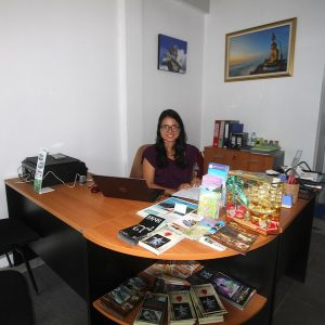 Alis at her desk