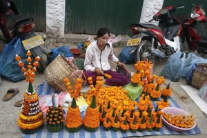 Selling garlanded flowers on the pavements, a regular sight