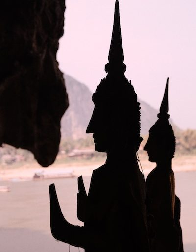 Buddhas statues tower above a magnificent scenery