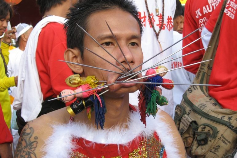 Face piercing at the Phuket vegetarian festival
