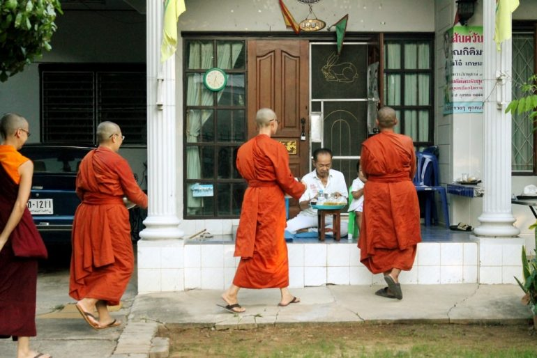 Bhikkhuni at the morning alms