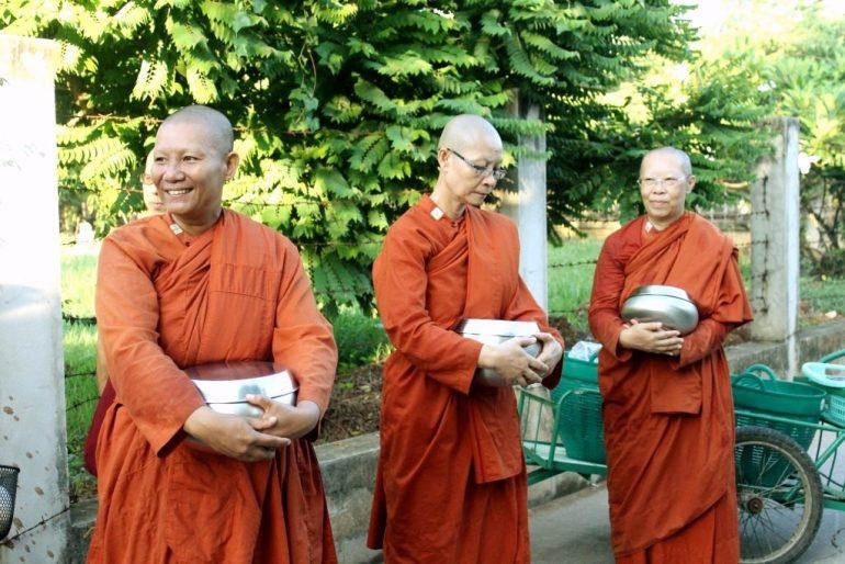 Bhikkhuni leaving the temple