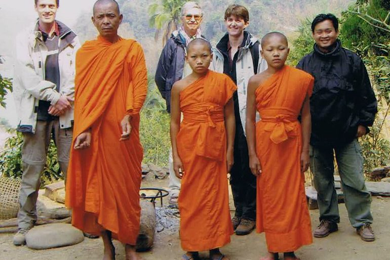 With a group pf young monks in the Laos jungle