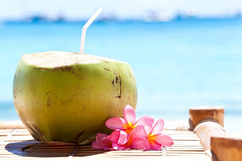 Coconut water enjoyed by the beach