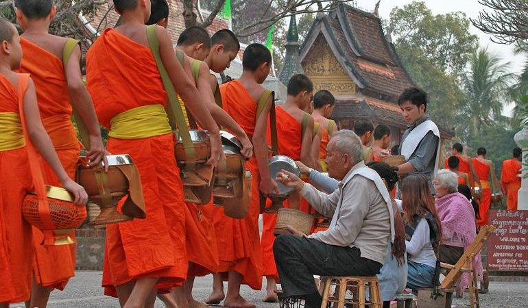 Early morning alms giving in Laos