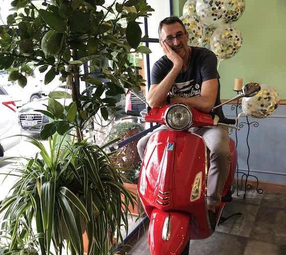 Fulvio Manini and his red Vespa, the Italian icon
