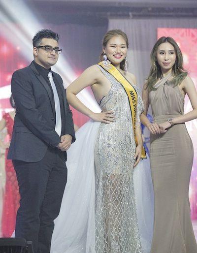 Miss Popular Vote winner receiving her prize from Borneo Medispa.