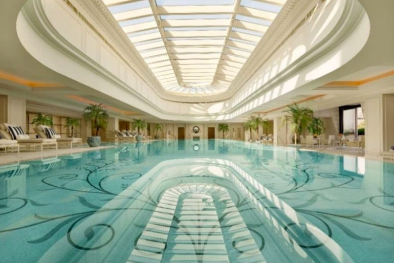 The Peninsula Shanghai's indoor pool is awash in natural light that showcases an elegant tile mosaic pattern