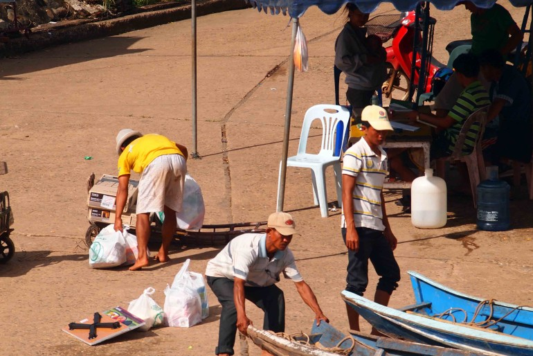 Boatmen on the cost of Laos