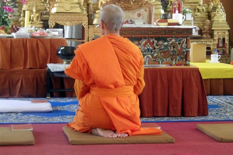 A lady monk praying the Buddha