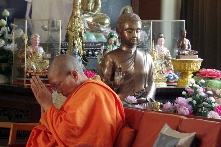 A lady monk praying the Buddha