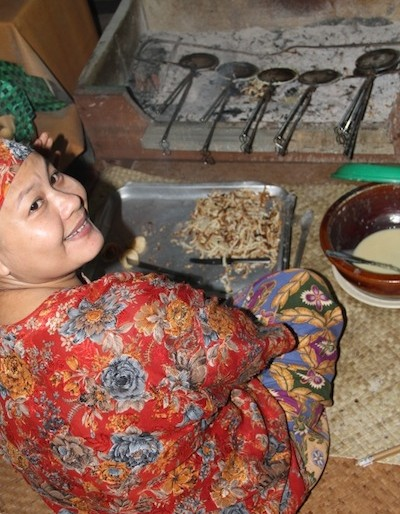 Iban cooking Kuih Jala inside the longhouse