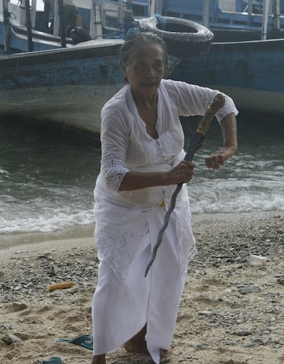 Local woman priest dancing with her kriss knife