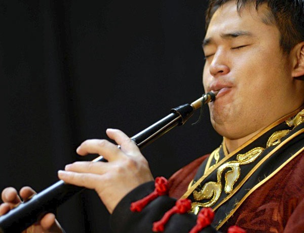 Member of Sedaa with a Bischgur, the Mongolian oboe