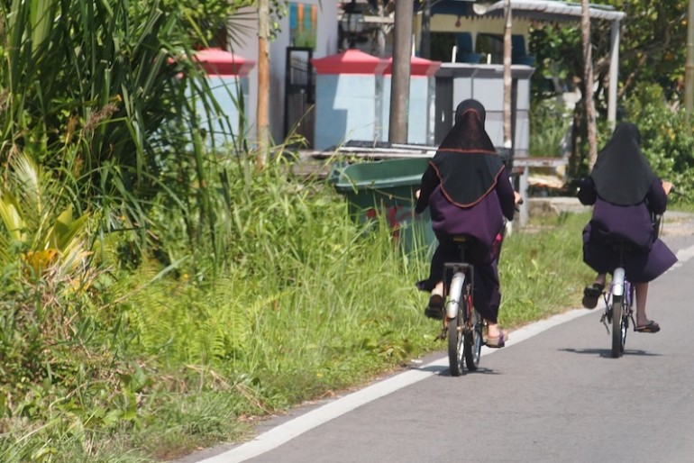 Locals cycling along rural roads