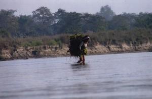 chitwan woman crossing the river