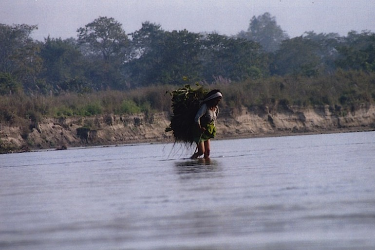 chitwan woman crossing the river