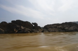 Mekong River with strange rock formations looking like a dog...