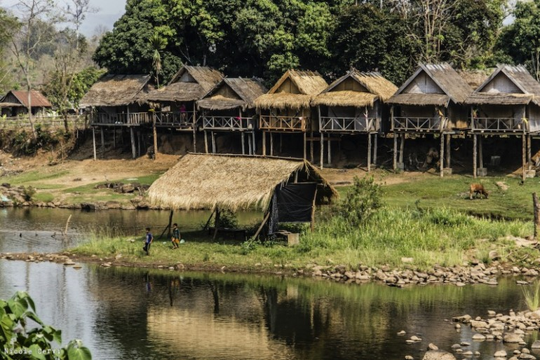 Wooden bungalows on the lakeside at Tad Lo waterfall