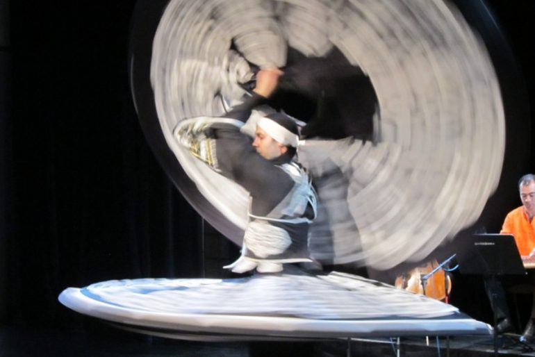 Dervish dance in a magnificent black-and-white dress