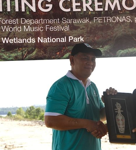 Petronas representative showing his memento