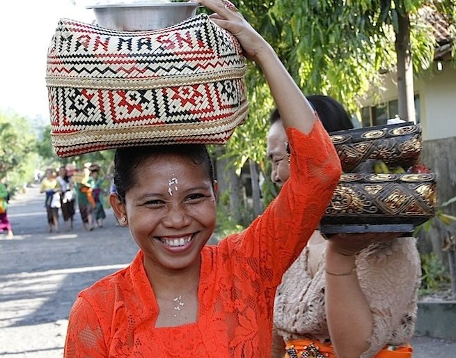 Local woman carrying the offerings to the spirits