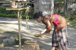 Woman attends her home bamboo altar