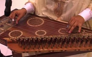 Kanun, a flat trapezoidal wooden box with 78 strings