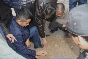 Playing Mahjong in the street