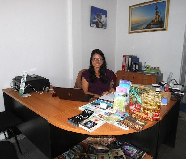 Alis at her desk
