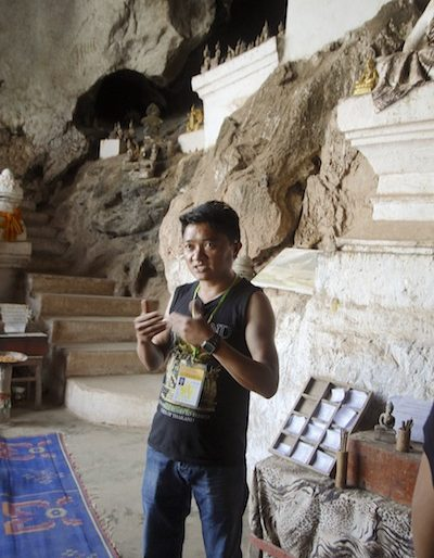 Our guide explaining the history of Pak Ou