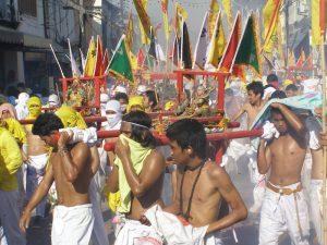 Carrying the Buddha in procession