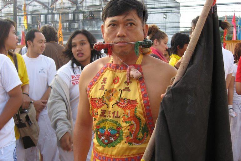 Face piercing at the Phuket vegetarian festival